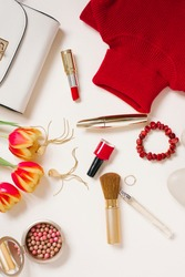 Clothing and cosmetics blogger for Valentine's Day and a bouquet of tulips. Top view