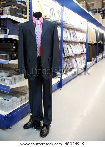 Clothing department of big market dummy in suit