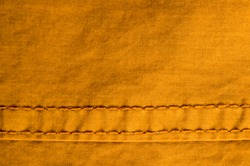 clothing items stonewashed cotton fabric texture with seams, clasps, buttons and rivets, macro
