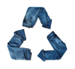 clothing recycling. Second-hand clothes. Recycling symbol with jeans