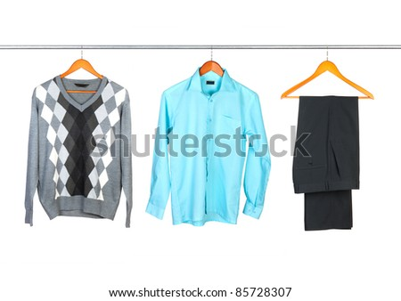 clothing set on wooden hangers sweeter, shirt and pants isolated on white - stock photo