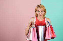 Clothing store. present packages for holiday preparation. summer discount. special offer on black friday. shop closeout. surprised woman shopper. big sale. female shopaholic hold shopping bags.
