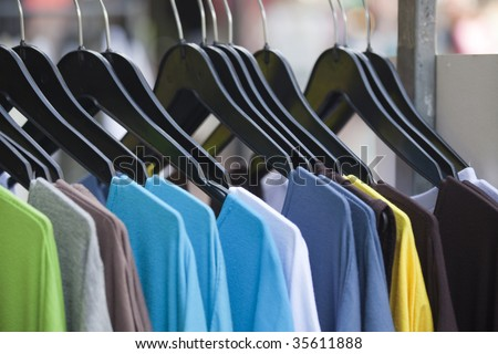 clothing store, t-shirts in a row