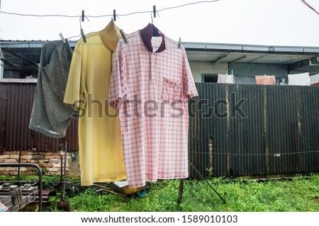 cloths hanging under rainy day