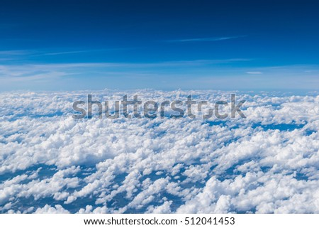 cloud above the blue sky from airplane window #512041453