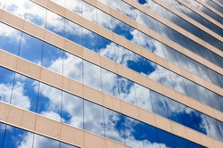Cloud and sky reflection in the windows of modern office