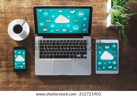 Cloud computing and social network interface on a laptop, tablet and smartphone screen #252721903