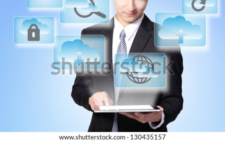Cloud computing concept - Business man touch tablet pc with cloud computing icon in the air