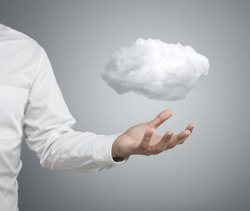 Cloud computing concept, close up of young businessman with cloud over his hand