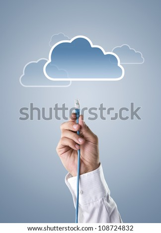 Cloud computing concept, male hand connecting cable to the cloud icon