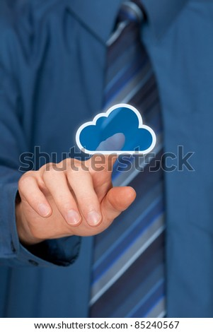 Cloud computing concept. Mans hand click on cloud icon ahead. Selective focused on forefinger.