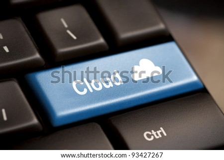 Cloud computing concept showing cloud icon on computer key.