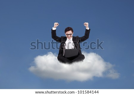 Cloud computing concept: Successful Asian businessman with laptop sitting on cloud