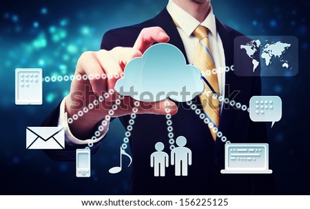 Cloud computing connection concept with business man on a blue technology background