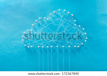 Cloud computing. Wired cloud made out of threads and pins