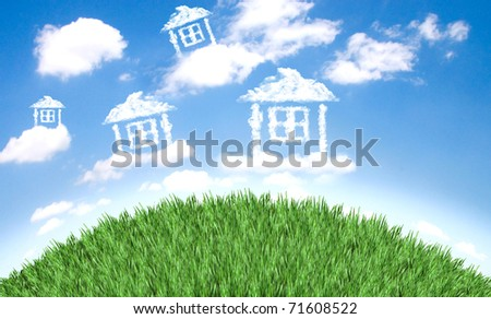 Cloud houses in the air over grass field