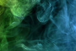 Cloud of  green and blue smoke on a black isolated background. Background from the smoke of vape