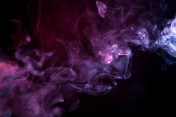 Cloud of  pink and purple smoke on a black isolated background. Background from the smoke of vape