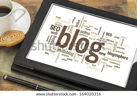 cloud of words or tags related to blogging and blog design on a  digital tablet with cup of coffee