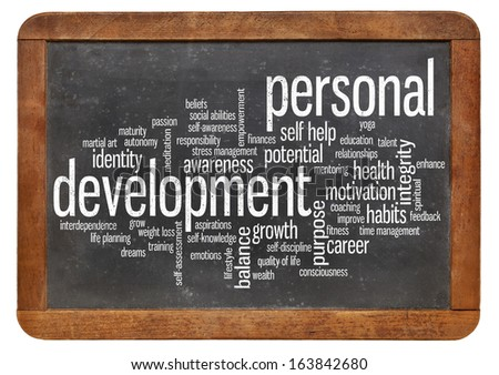 cloud of words or tags related to personal development  on a  vintage slate blackboard isolated on white