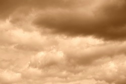 Cloud on a sepia color sky background. High resolution photo.