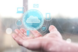 Cloud technology concept above a hand of a man