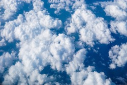 Cloud top view. beautiful natural cloudscape and sky Aerial view of Blue sky from airplane window.