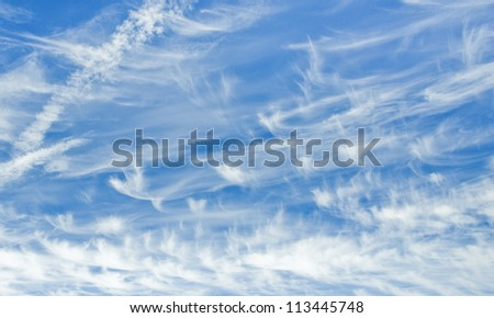 cloudescape of cirrus clouds and aircraft vapor trails
