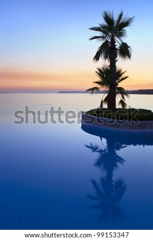 Cloudless morning on Adriatic Sea and its reflection in pool.