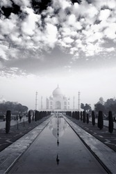 Clouds above Taj: The picture shows the white morning clouds over beautiful Tajmahal and its perfect reflection.