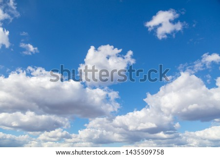 Clouds against blue sky as background. #1435509758