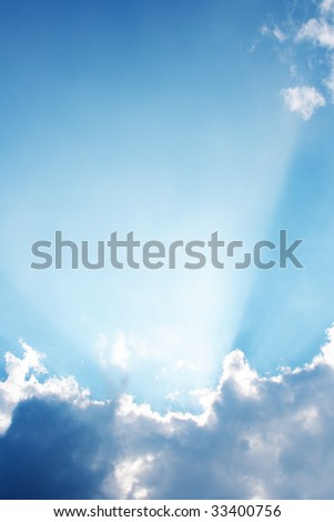 Clouds and a blue sky with a sunbeam shining through