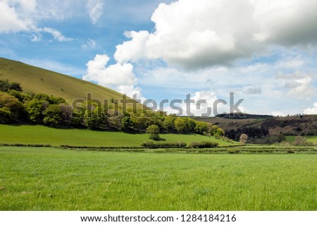 Clouds and blue skies over the farmland in the Welsh countryside of Radnorshire.