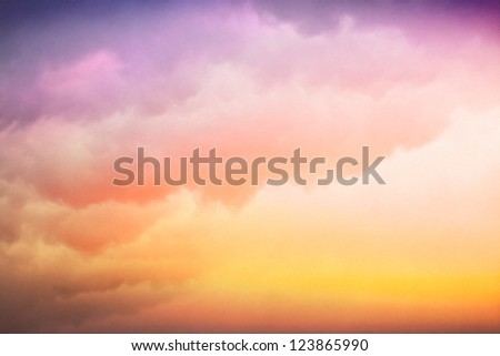 Clouds and fog with a colorful yellow to purple-blue gradient.  Image displays a pleasing paper texture visible at 100%.