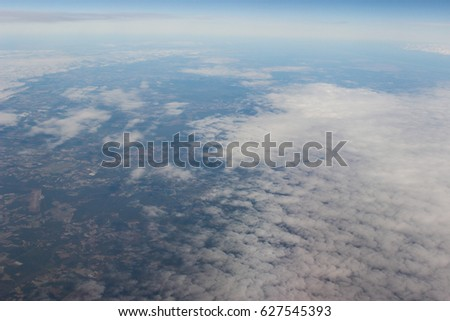 Clouds and land viewed from above #627545393