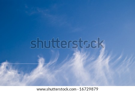 clouds and plane passing on blue sky