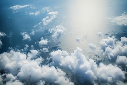 Clouds and sea aerial view as seen in window of an aircraft
