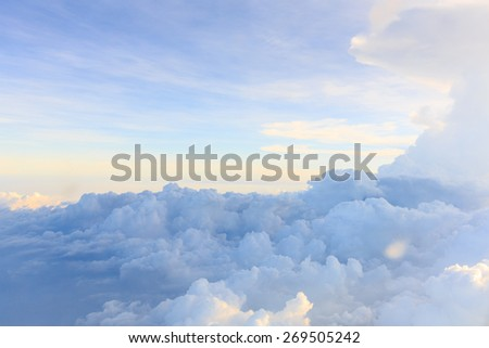 Clouds and sky as seen through window of an aircraft #269505242