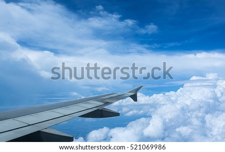 Clouds and sky as seen through window of an aircraft,Classic image through aircraft window onto jet engine,Looking through window aircraft during flight a nice blue sky,Aircraft Window,airplane window #521069986