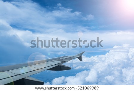 Clouds and sky as seen through window of an aircraft,Classic image through aircraft window onto jet engine,Looking through window aircraft during flight a nice blue sky,Aircraft Window,airplane window #521069989