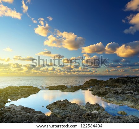 Clouds and sky during bright sunset. Natural seascape