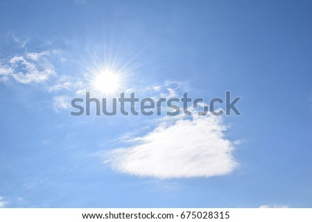 Clouds and sunshine and blue sky - Shutterstock ID 675028315