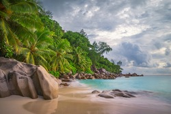 clouds at tropical beach anse georgette on praslin on the seychelles