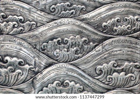 Clouds carving on silverware
