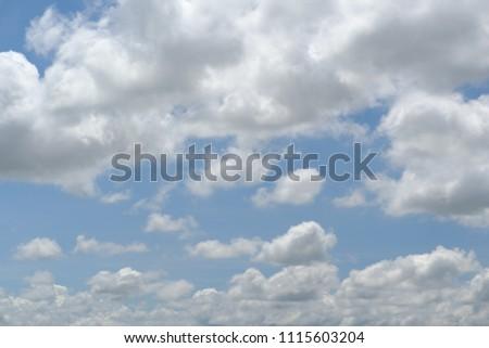 clouds fluffy in blue sky #1115603204