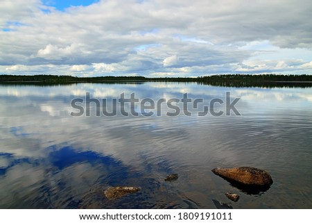 Clouds fly across the sky. Lake Keret, Northern Karelia, Russia Stock fotó ©