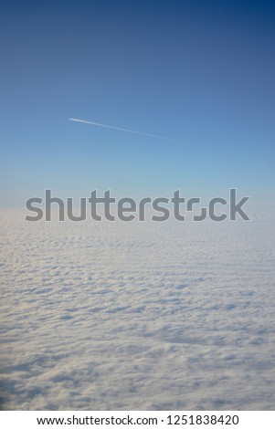 Clouds from the airplane window, from above, the sky above the ground, from the plane. #1251838420
