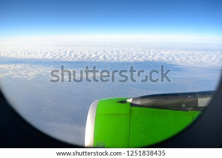 Clouds from the airplane window, from above, the sky above the ground, from the plane. #1251838435