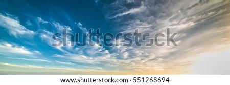 clouds in a blue and orange sky