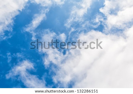 Clouds in blue sky as a background
